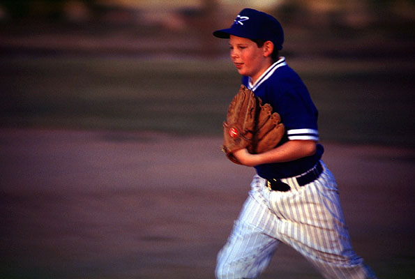 Baseball Teams - Young Baseball Player Running with Glove - Blue Shirt and Cap with White Pants - Linked to the Baseball Page - Pro Sports Official Team Sites
