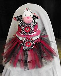 Cute Cow With Pink and Black Tutu Cute Cow Security blanket with pink and black zebra tutu. Includes 75 diapers (Pampers Swaddle size 1)