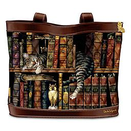 """Charles Wysocki Cat Art Tote Bag: Frederick The Literate Acclaimed artist Charles Wysocki's famous cat art adorns this quilted fabric tote bag. Cat charm zipper pull, 2 inner pockets, 2 FREE cosmetic cases. Measures 14"""" W; drop measures 9"""""""