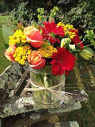 Autumn Joy A brilliant display of fall colors, our bouquet includes 'Cherry Brandy' Roses, gerbera daisies, helenium, buplureum, tulips and yarrow. Colors are as brilliant as the New England landscape!