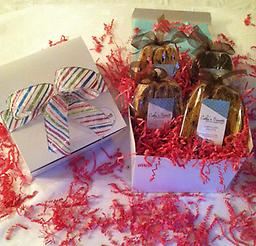 Biscotti Gift Box -Medium Our exquisite medium gift box contains 4 gourmet biscotti bags. Each gift is finished with a festive ribbon and a hand written gift card.