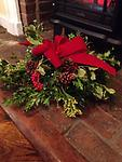 Evergreen centerpiece - This collection of winter greens combines holly, cedar, boxwood, juniper and pine with Christmas decorations that will last for weeks.