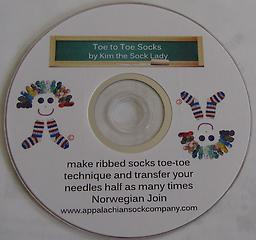 DVD Knitting Toe-to-Toe learn how to knit ribbed socks and transfer stitched half as many times