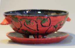 Berry Bowl B Holds 3 to 4 cups of any fruit, separate under dish. Decorative and entertaining ready to dress-up your table. Strawberry deigns on white stoneware.