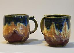 Mugs A Holds 14 oz. of you favorite beverage. Glaze designs on white stoneware, high fired.