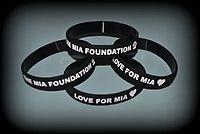Black Wristband Says Love for Mia on one side and The Mia Foundation on the other side.