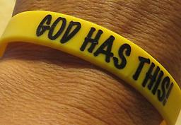 "Adult size ""God Has This"" yellow bracelet with black writing Adult size ""God Has This"" yellow bracelet with black writing"