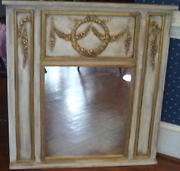 0157 Old World French MirrorThis beautiful work of art combining lincrusta, clay and plaster applications along with beautiful wood moldings is trumeau inspired. It is solid wood with 3 dimensional relief