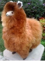 """Alpaca to Cuddle! Your very own alpaca to love! This fluffy and soft alpaca is a """"must have"""" gift for anyone who wants to HUG an ALPACA! This stuffed animal is 11"""" tall, and made from 100% Baby Alpaca fiber. Silky soft"""