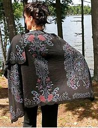 Black Midnight Rev. Alpaca Ruana Black on one side and Blue on the other with contrasting hand-embroidered work! Alpaca soft!