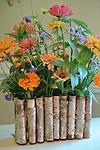 Birch Bark Folder - Natural birch bark is carefully folded to form this unique container. Into every pocket a singular test tube is inserted to hold water and stems. It's the ultimate easy-to-use vase.
