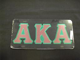 AKA Black Car Tag with Pink Letters Trimmed in Green Mirrored.