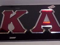 Kappa Black Mirrored Car Tag with Red Letters Red letters.