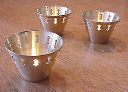 Brass cup tea light Brass Cup Tea Light; Tea candle is included. Price is per each