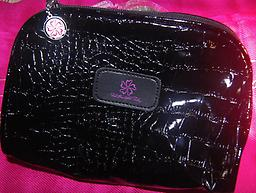 Makeup Bag Beautiful imprinted makeup bag is made of shiny black vinyl, with an authentic crocodile look, ample size of the bag makes it ideal for carrying all of your accessories.