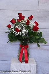 Dozen Roses 12 Beautiful long stemmed roses come expertly arranged in a glass vase, filled with assorted greenery and babies breath. Our roses are the highest quality, coming from premium growers in Columbia.