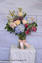 Lovely Spring This stunning bouquet of roses, hydrangea, parrot tulips, stock, forsythia, and astrantia will show her just how much you care about her, whether a birthday, anniversary, or just because.