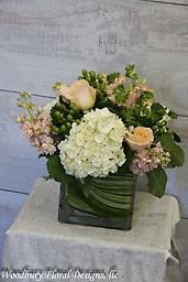 Peachy Keen! Soft and pleasing to gaze upon- Peach roses, hydrangea, stock and hypericum berries all wrapped up with an aspidestra leaf will catch everyone's attention with it's simple beauty!