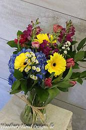 Countryside Bouquet Hydrangea, gerbera daisies,snapdragons, ranunculus and tulips come together to make this bouquet stand out.