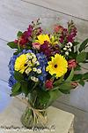 Countryside Bouquet - Hydrangea, gerbera daisies,snapdragons, ranunculus and tulips come together to make this bouquet stand out.