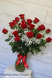Two Dozen Red Roses 24 brilliant roses are expertly arranged in a vase, complete with assorted greens and babies breath. The ultimate symbol of love!