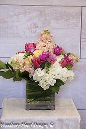 Pastel Dream Modern day cube arrangement with hydrangea, parrot tulips, stock and freesia all wrapped in an aspidestra leaf. Perfect for your Valentine, or any occasion!