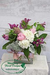 Pink Bombshell Stunning clematis, white hydrangea, peonies and hyacinths will make this a bouquet they will never forget!