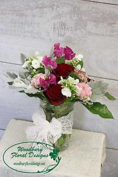 With Love This lovely combination of roses, phlox, ranunculus and sweet pea are a perfect way to show you care.