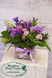 Lavender Dreams A modern arrangement of lavender roses, fragrant hyacinths, stock, and clematis will put spring in anyone's step.
