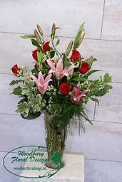 Classic Lilies and Roses A classic combination of red roses and fragrant oriental lilies, this gift will be remembered for years to come.