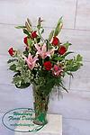 Classic Lilies and Roses - A classic combination of red roses and fragrant oriental lilies, this gift will be remembered for years to come.