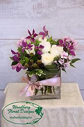 Blackberry Delight This modern collection of fragrant garden roses, clematis, and phlox and roses adorned with blackberries is sure to be the talk of the town!