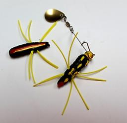 LARGE AL'S FUZZ BLACK W/RED & YELLOW DOTS YELLOW LEGS GOLD SPINNER
