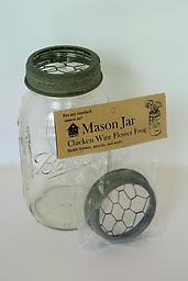 Mason Jar Flower Frog This handy lid turns any standard Mason jar into an easy-to-arrange-in vase. Oh... and did we mention the rustic charm of chicken wire frog and barn roof finish? Talk about form and function.*
