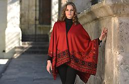 Ruana: Rev. Riches of Corazon in Alpaca Bold red or dark, mysterious black? Whatever your mood, this reversible ruana makes a warm and stylish entrance or easy, on-the-go flare on a cool day.