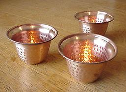 Copper bell tea light Copper Bell Tea Light; Tea candle is included. Price is per each