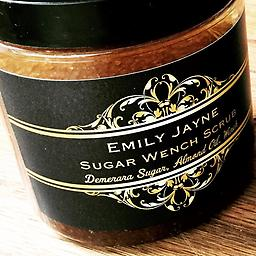 SugarWench Scrub A scandalously naughty combo of Sweet Almond Oil, Demerara Sugar and our best-selling Wench fragrance. Exfoliate and hydrate all in one luxurious step. 8 oz.