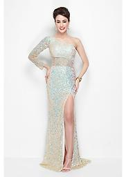 Nude Primavera 9818 More than meets the eye in a lovely gown from Primavera Couture 9818. This one shoulder item features a single long sleeve with an illusion back. Brilliant adornments shine off of the length.