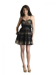 Black/Nude Dave and Johnny 8508 This best-dressed short formal by Dave and Johnny 8508 makes sweet music. The figure-defining crossover bodice features sheer tucks of fabric atop a neutral-toned lining for sensuous dimension.