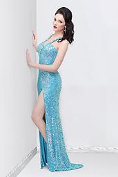 Ice Blue Primavera 9870 Be haute couture in a stylish gown from Primavera Couture 9870. This halter style connects at your back and reveals a daring rounded cutout. Glamorous sequins sizzle off the full length.