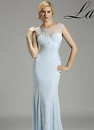 Blue Lara Design 2020 Get glamorous in this enchanting evening dress from Lara 2020. The illusion bodice has sheer cap sleeves and asymmetrical details adorned with twinkling tonal crystals.