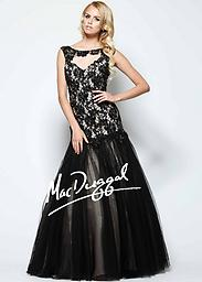 Black Mac Duggal 48200 Burst with beauty in an animated gown from Mac Duggal 48200H. A boat neck and subtle cap sleeves are emphasized with illusion fabric to craft a magical effect.