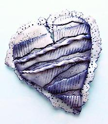 Silver Lace Heart A modern take on a Victorian lace heart with dimensional layers