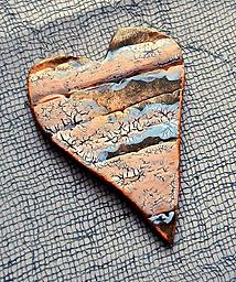 Landscape Heart Brooch Metallic color and crackle texture create a landscape pattern on this heart brooch.