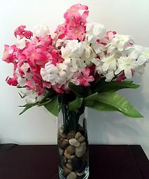 Artificial Flower arrangement, Crafts by Nadia Pink and white flower arrangement with glass vase filled with ornamental rocks.