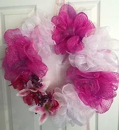 Artificial Door Wreath, Crafts by Nadia Artificial Door Wreath, floral flowers with sparkles, and purples sparkly tulle with pink and purple ribbon.