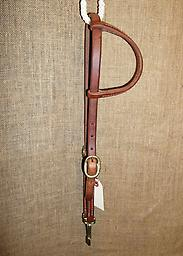 """5/8"""" Harness leather double cheekone-ear headstall 5/8"""" Hermann Oak harness leather headstall. One rolled ear-piece. Double cheeks with brass buckles and brass quick snaps at bit ends."""