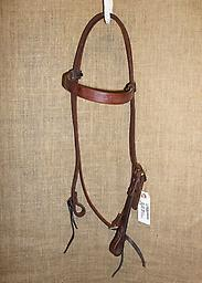 "5/8"" headstall with laced brow and single cheek 5/8"" Hermann Oak harness leather headstall with laced brow. Single cheek with brass buckle. Leather ties at bit ends."