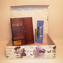 """A4-The Original-Live, Laugh, Love This beautiful purple and white tab box contains Paperblanks Lussuria Ultra Wrap lined 7"""" x 9"""" journal, 5"""" gold or silver glitter pen, and 4 1/2"""" metal bookmark with green ribbon and beaded trim: """"Bel"""
