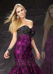 Black/ Magenta Mac Duggal 75922M This prom gown with flower accent is the new definition of sweet sophistication. Dress has sweetheart neckline with laced flared mermaid skirt. Pictured in Black/Magenta.
